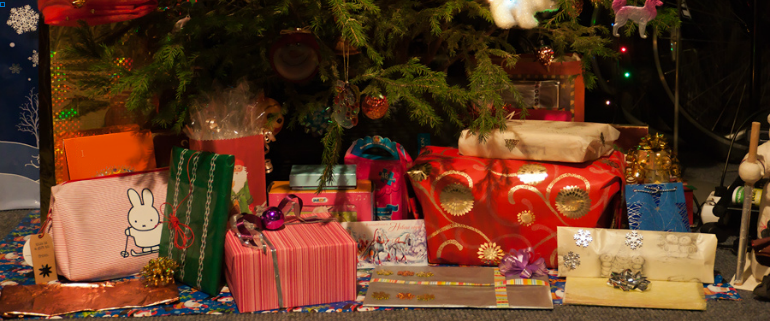 Christmas gifts under the tree by ahenobarbus via Flickr (cropped)
