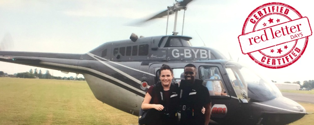 Lorraine and Marvin standing in front of the helicopter about to take them on a tour over London.