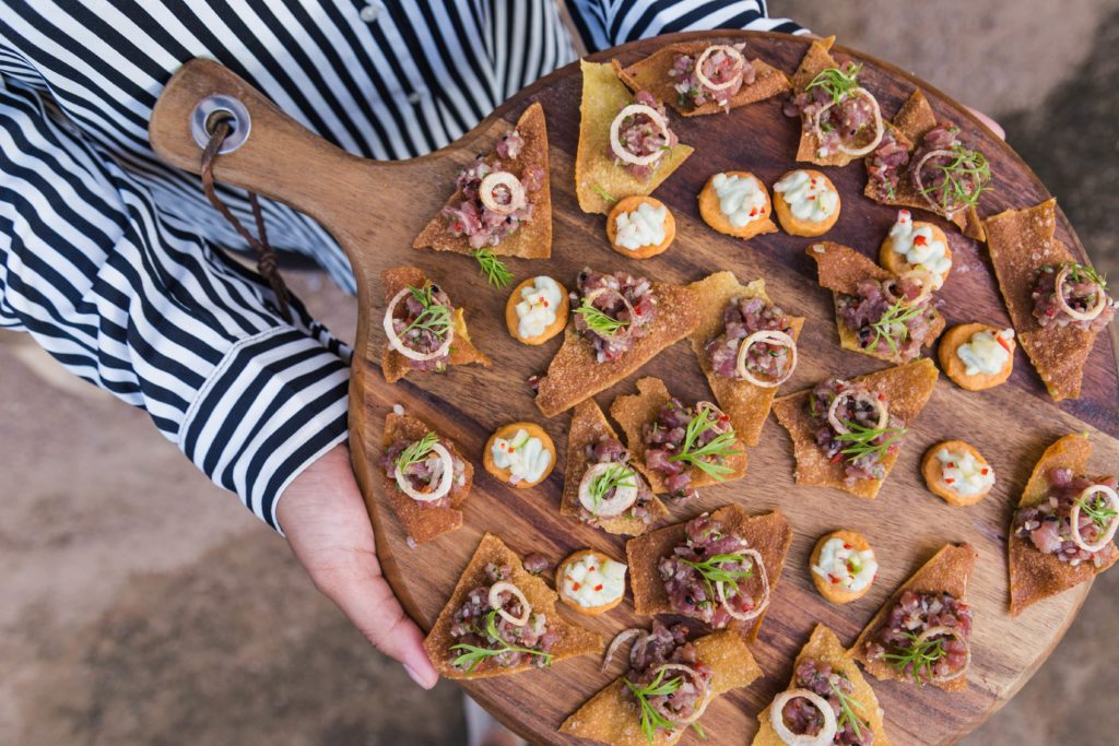 Woman holding a tray of canapes
