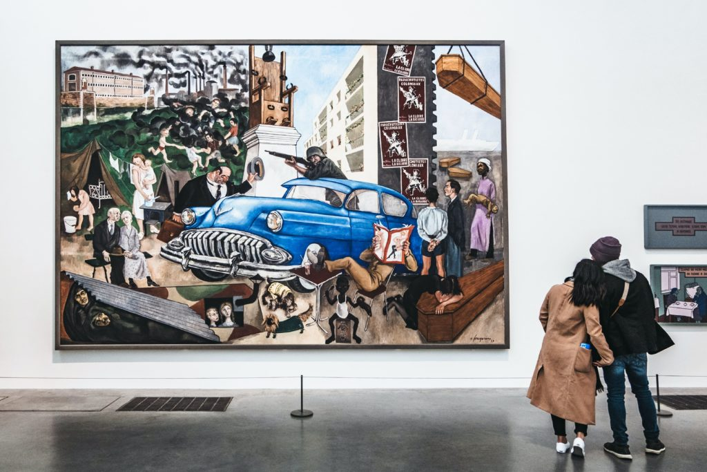Couple looking at modern painting of a car at Tate Modern