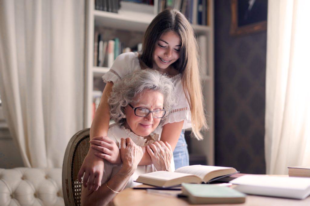 Grandmother and granddaughter hugging
