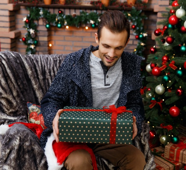 man opening christmas present