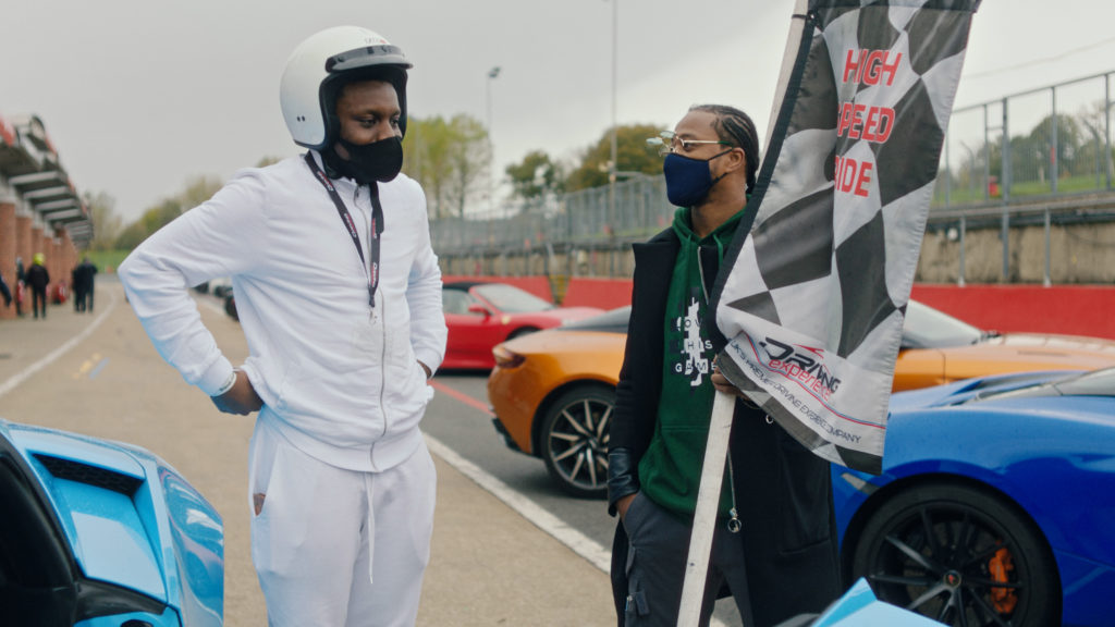 Patrice Evra and young carer at Brands Hatch for a supercar day