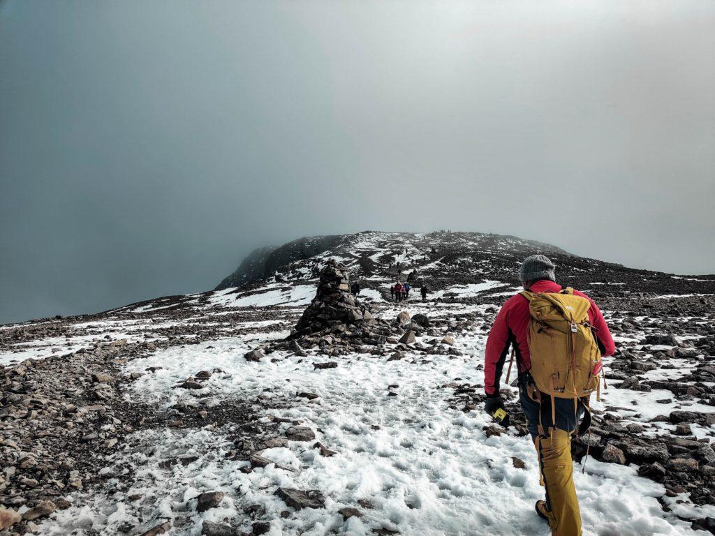 man walking up ben nevis mountain