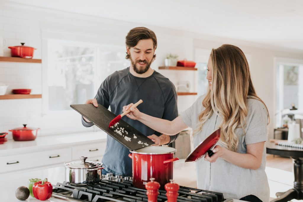 man and women cooking a meal