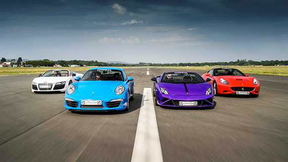 4 supercars lined up on a track